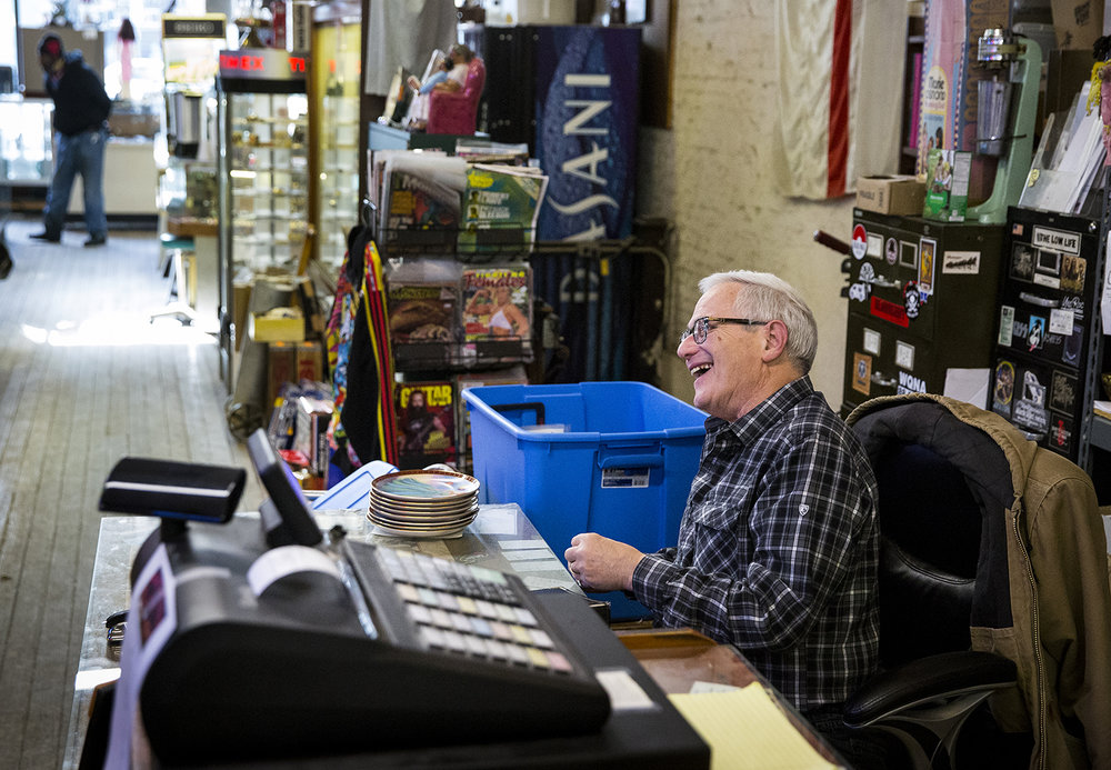 Mark Kessler talks with a customer Monday at Recycled Records in Springfield. [Rich Saal/The State Journal-Register]