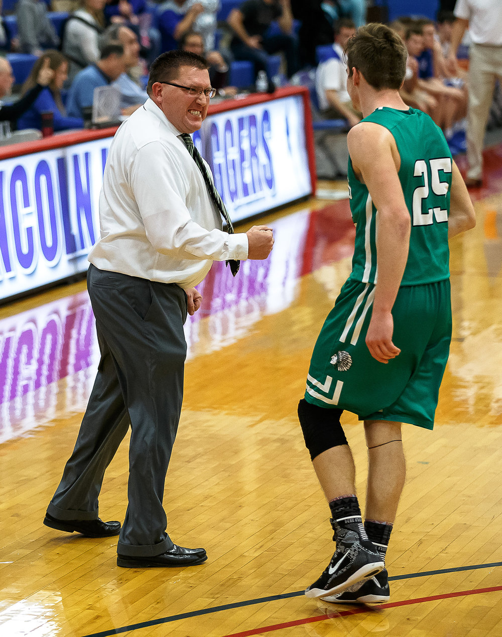 Athens boys basketball head coach Jeff Johnston celebrates with Athens' Drayton Davis (25) after he created a turnover and made a shot that put the Warriors up 48-47 against Auburn in the second half during opening night of the Boys Sangamon County Tournament at Lincoln Land Community College's Cass Gymnasium, Monday, Jan. 8, 2018, in Springfield, Ill. [Justin L. Fowler/The State Journal-Register]