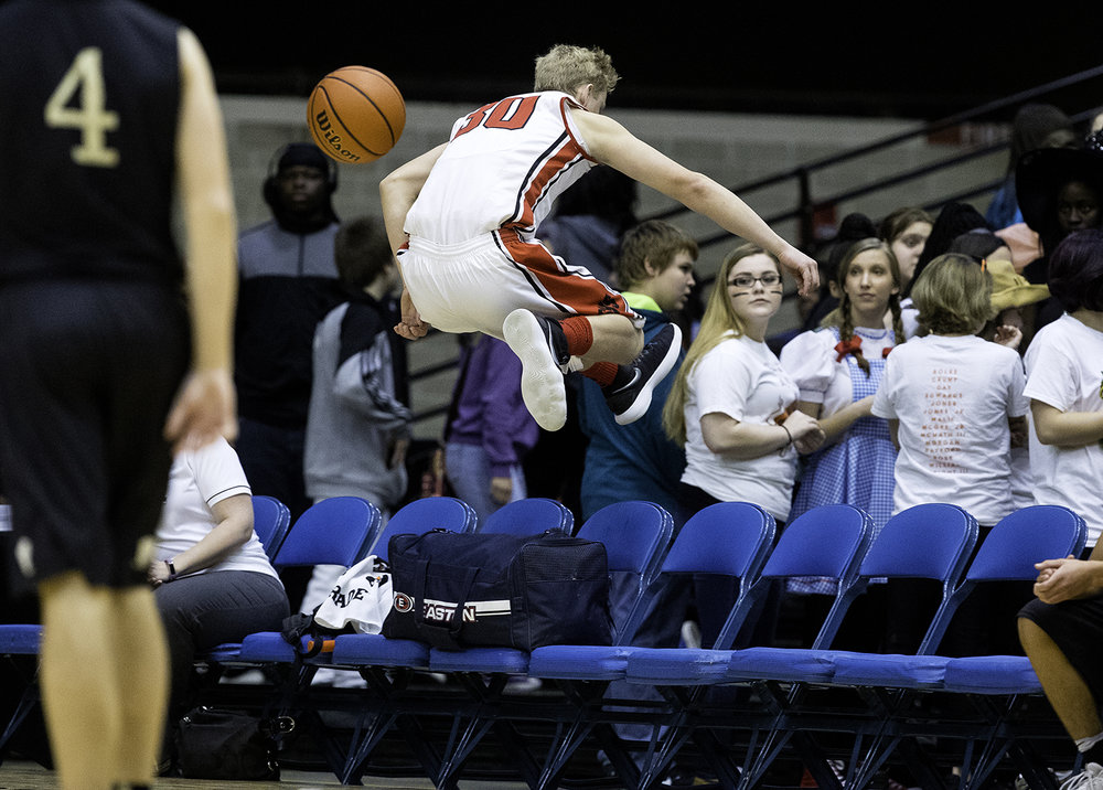 Springfield's Will Reiser leaps over the bench as he pursues a loose ball against Sacred Heart-Griffin during the Boys City Tournament at the Bank of Springfield Center Saturday, Jan. 20, 2018. [Ted Schurter/The State Journal-Register]
