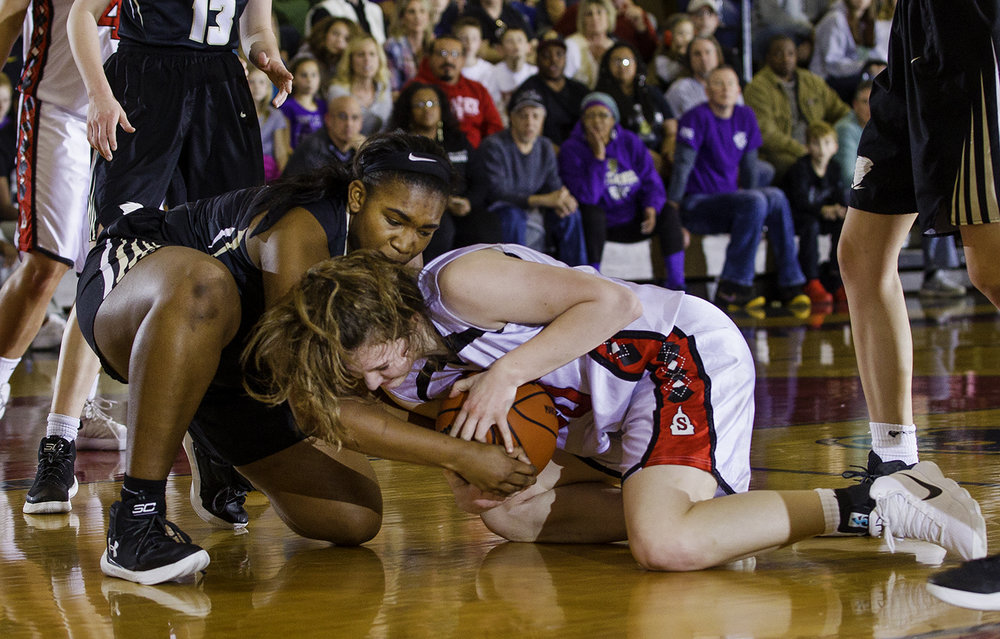 Sacred Heart-Griffin's Jalen Butler and Springfield's Abby Ratsch fight for a loose ball on the floor during the Girls City Tournament at Springfield High School Saturday, Jan. 26, 2018. [Ted Schurter/The State Journal-Register]