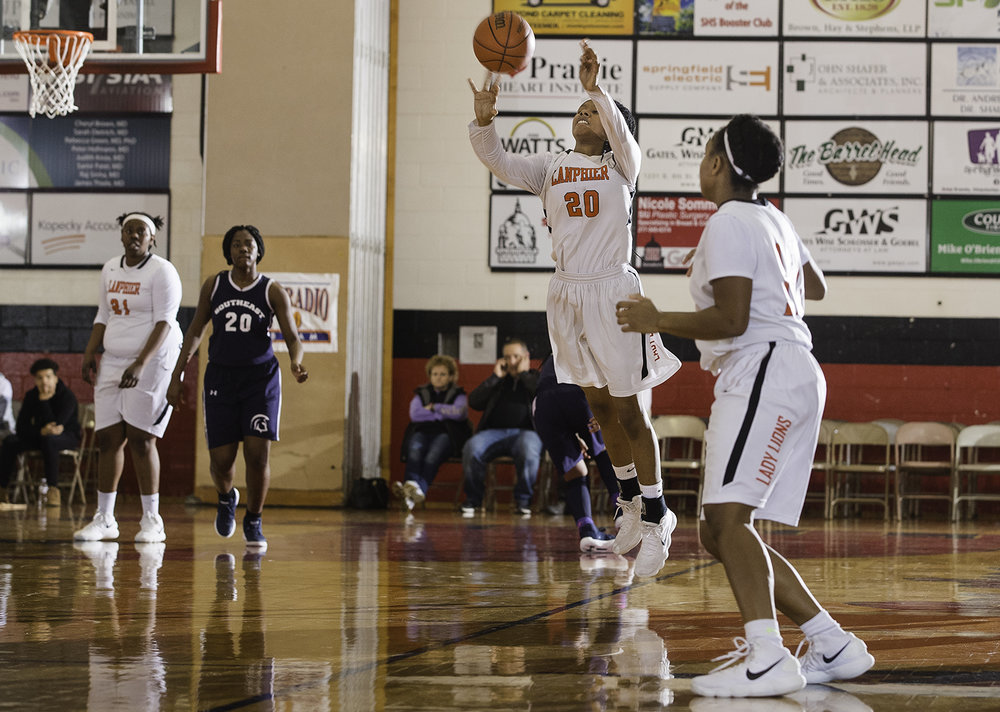 Lanphier's Serenity Price fires a last second half court shot to end the first half against Southeast during the Girls City Tournament at Springfield High School Saturday, Jan. 26, 2018. [Ted Schurter/The State Journal-Register]