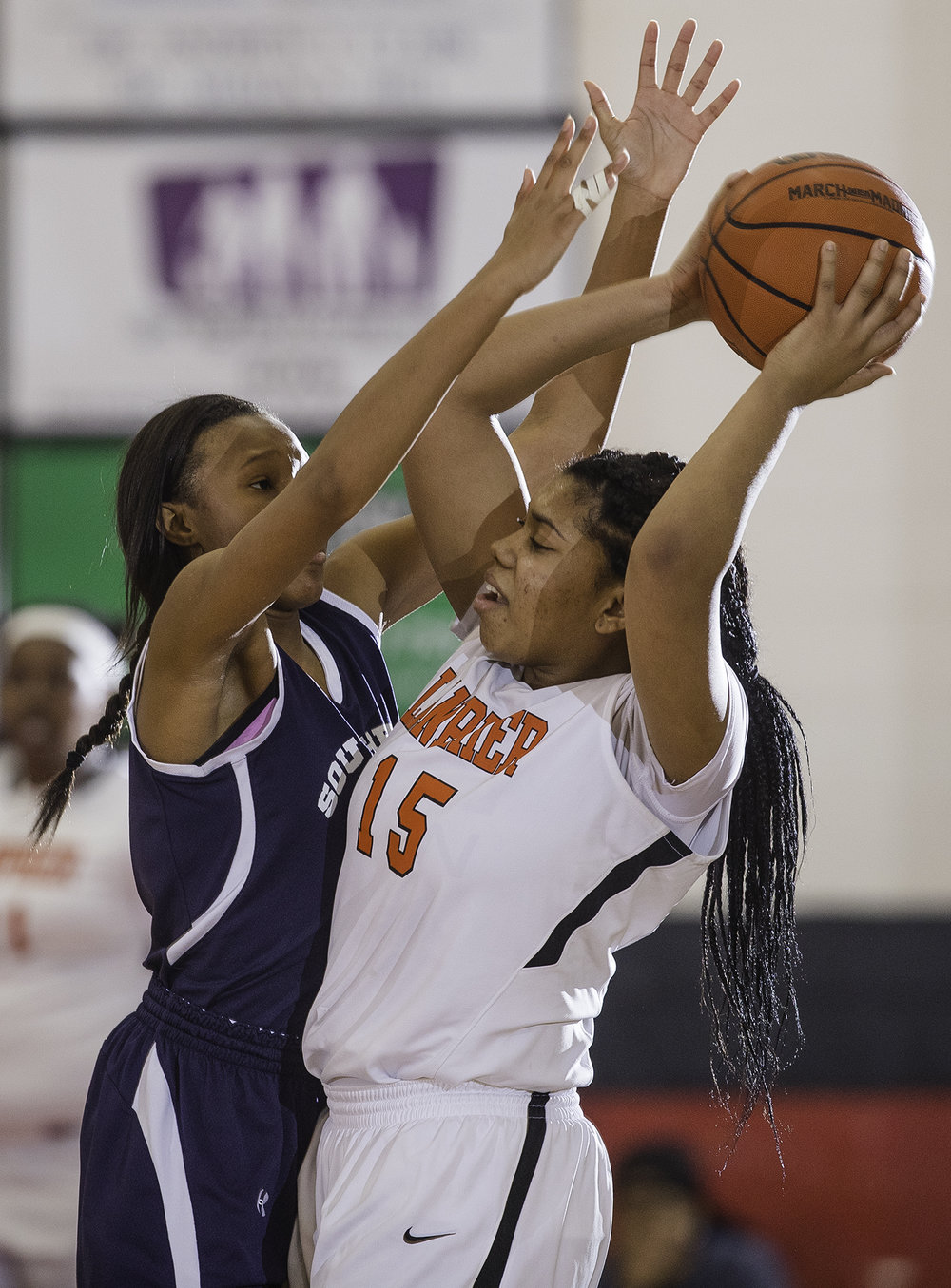Southeast's Osiana Small tries to pass the ball under pressure from a Lanphier defender during the Girls City Tournament at Springfield High School Saturday, Jan. 26, 2018. [Ted Schurter/The State Journal-Register]