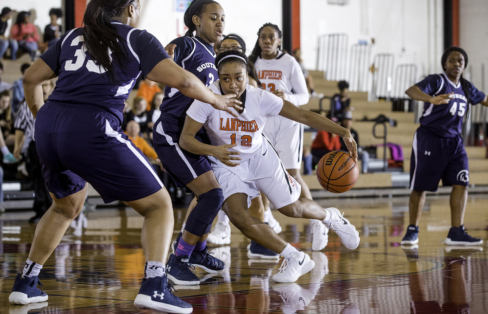 Lanphier's Destiny Allen drives into the Southeast  defense during the Girls City Tournament at Springfield High School Saturday, Jan. 26, 2018. [Ted Schurter/The State Journal-Register]