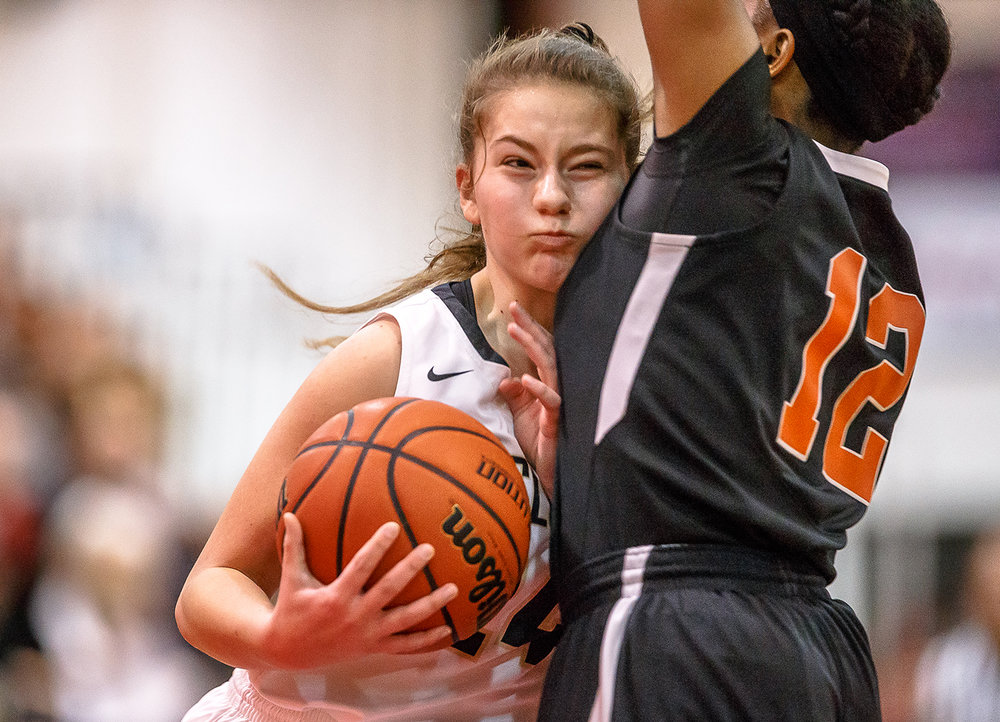 Sacred Heart-Griffin's Sofia Lowis (24) collides with Lanphier's Destiny Allen (12) as she drives to the basket in the first half on the opening night of the Girls City Tournament at Springfield High School, Wednesday, Jan. 24, 2018, in Springfield, Ill. [Justin L. Fowler/The State Journal-Register]