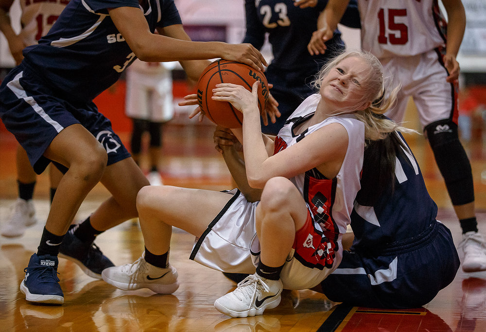 Springfield's Shay Doty (4) battles for a possession on the floor against Southeast in the first half on the opening night of the Girls City Tournament at Springfield High School, Wednesday, Jan. 24, 2018, in Springfield, Ill. [Justin L. Fowler/The State Journal-Register]