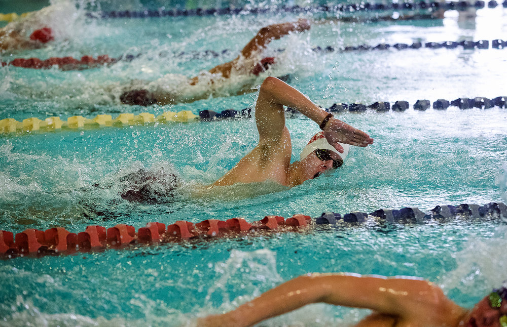 Jacksonville's Adam Schumacher competes in the 100 freestyle during the Central State 8 Boys Swimming and Diving event at Eisenhower Pool Saturday, Feb. 3, 2018. [Ted Schurter/The State Journal-Register]