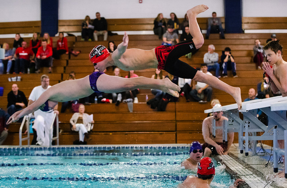 Glenwood's Nate Reed leaps off the block during the 400 freestyle relay during the Central State 8 Boys Swimming and Diving event at Eisenhower Pool Saturday, Feb. 3, 2018. [Ted Schurter/The State Journal-Register]