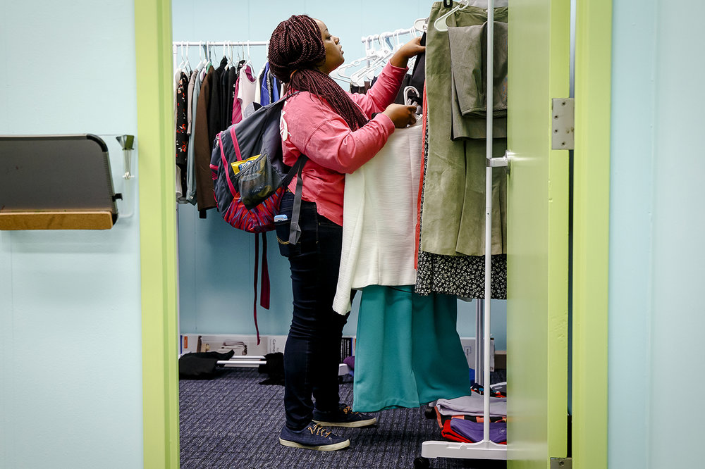 "Brittany Willis, a sophomore studying social work at the University of Illinois Springfield, looks through items of professional clothing to use for an upcoming job interview while taking advantage of the UIS Professional Clothing Closet, operated by the Career Development Center, at the UIS Diversity Center, Tuesday, Jan. 30, 2018, in Springfield, Ill. ""I just want a more professional look and to be prepared for my future,"" said Willis. The clothes are free to students and were donated by the UIS and Springfield community during a professional clothing drive during National Career Development Month last November. ""Our goal is help our students to be able to present themselves in professional actives, whether that is jobs, internships or networking events,"" said Kathy Battee-Freeman, the director of the UIS Career Development Center. [Justin L. Fowler/The State Journal-Register]"