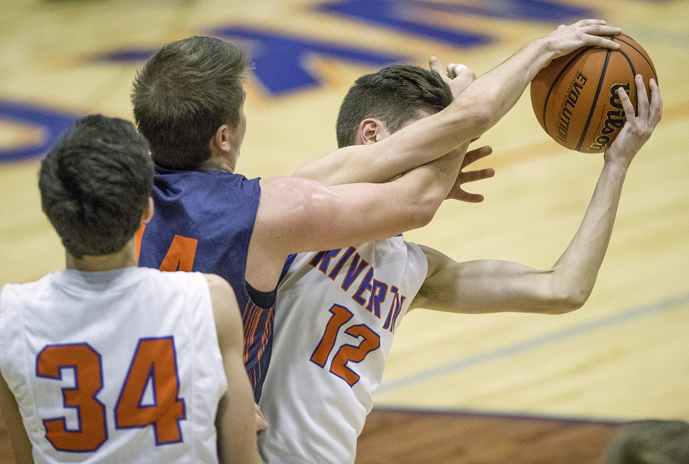 New Berlin's Casey Bixby gets an arm in front of Riverton's Chase Myers' face at Riverton High School Friday, Feb. 2, 2018. [Ted Schurter/The State Journal-Register]