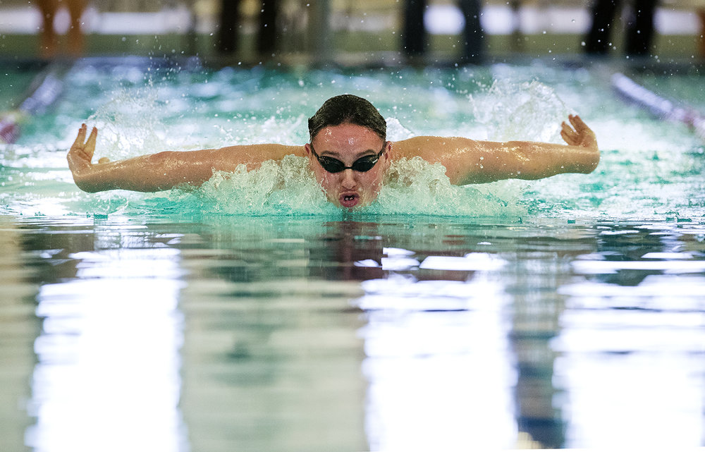Jacksonville's Max Willner competes in the 100 butterfly during the Central State 8 Boys Swimming and Diving event at Eisenhower Pool Saturday, Feb. 3, 2018. [Ted Schurter/The State Journal-Register]