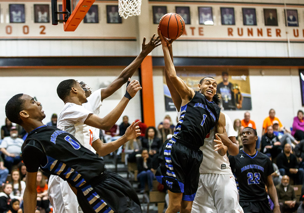 Decatur MacArthur's Zach Briggs (1) goes for a rebound against Lanphier's Herb McMath (50) in the second half at Lober-Nika gymnasium, Saturday, Feb. 10, 2018, in Springfield, Ill. [Justin L. Fowler/The State Journal-Register]