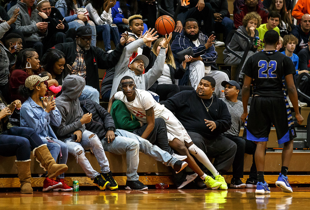 Lanphier's James Jones (21) goes into the crowd going after a loose ball against Decatur MacArthur in the second half at Lober-Nika gymnasium, Saturday, Feb. 10, 2018, in Springfield, Ill. [Justin L. Fowler/The State Journal-Register]