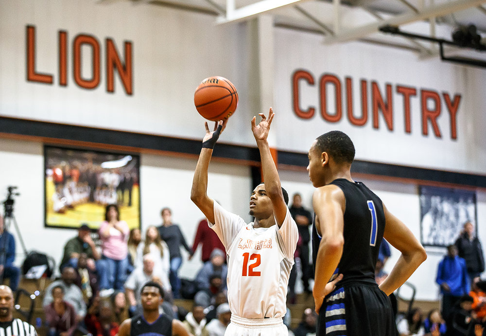 Lanphier's Cardell McGee (12) shoots a free throw to put Lanphier up 60-59 over Decatur MacArthur with :01 seconds left on the clock in the second half at Lober-Nika gymnasium, Saturday, Feb. 10, 2018, in Springfield, Ill. [Justin L. Fowler/The State Journal-Register]