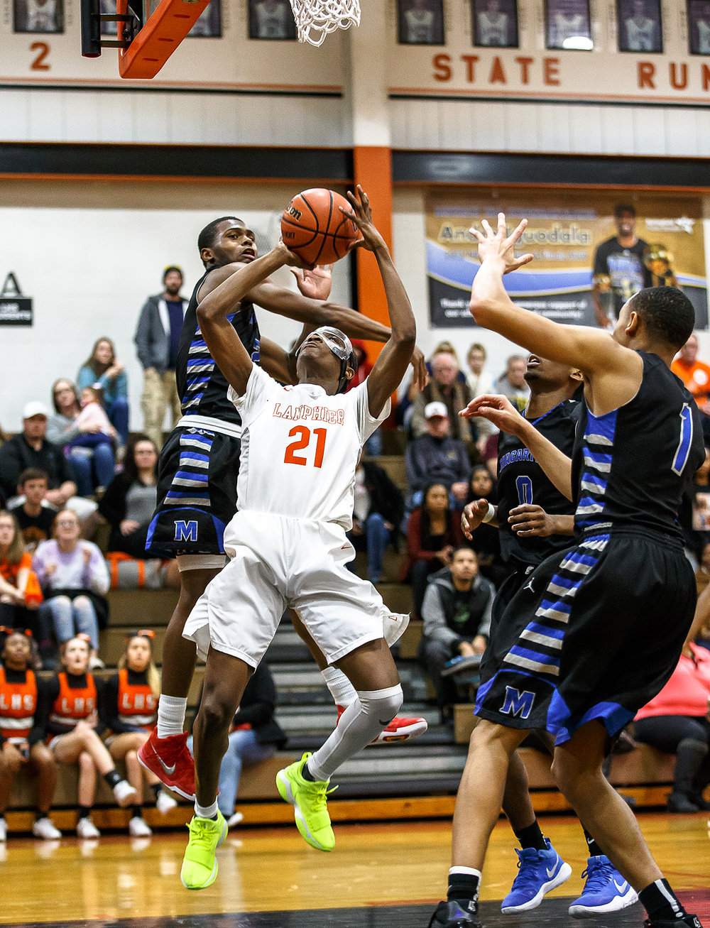 Lanphier's James Jones (21) puts up a shot to tie the game 59-59 against Decatur MacArthur's Armon Brummett (2) late in the second half at Lober-Nika gymnasium, Saturday, Feb. 10, 2018, in Springfield, Ill. [Justin L. Fowler/The State Journal-Register]