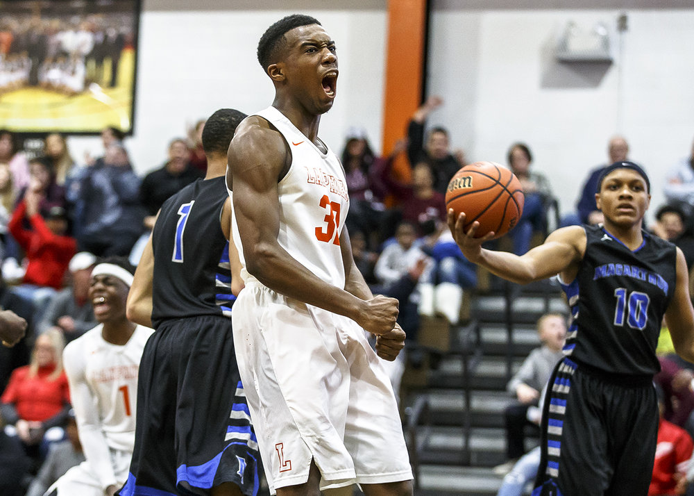 Lanphier's Karl Wright (32) roars after a dunk against Decatur MacArthur in the first half at Lober-Nika gymnasium, Saturday, Feb. 10, 2018, in Springfield, Ill. [Justin L. Fowler/The State Journal-Register]