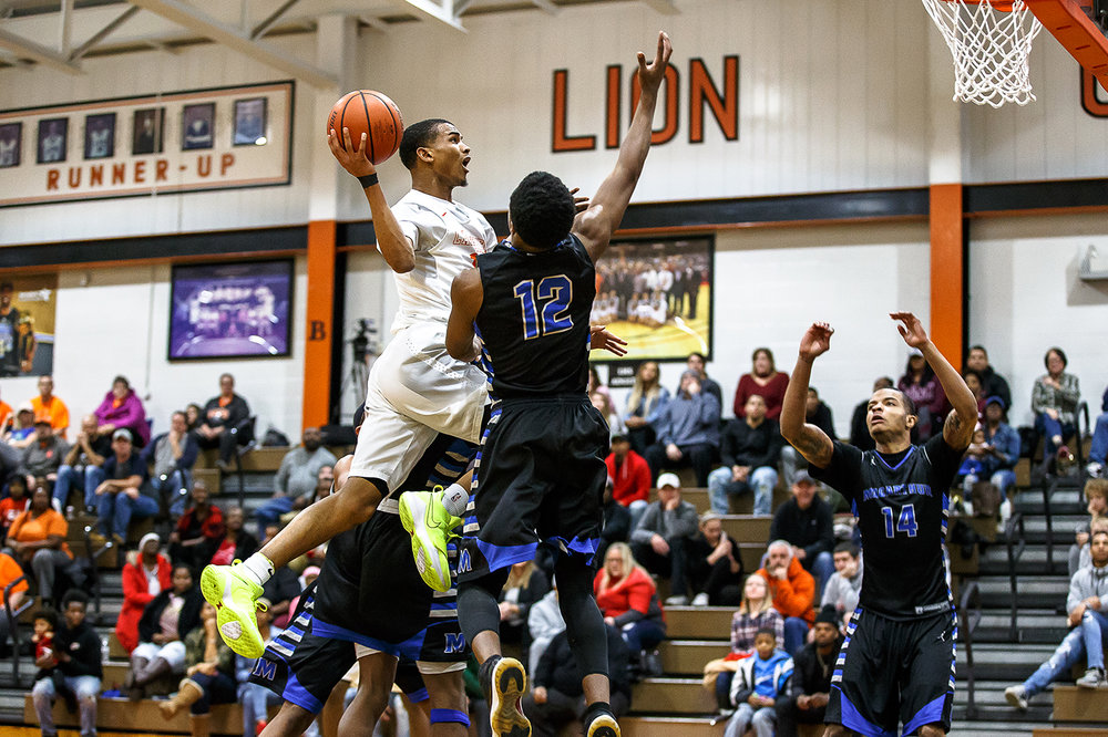 Lanphier's Cardell McGee (12) goes up to the basket against Decatur MacArthur's Amir Brummett (12) in the first half at Lober-Nika gymnasium, Saturday, Feb. 10, 2018, in Springfield, Ill. [Justin L. Fowler/The State Journal-Register]