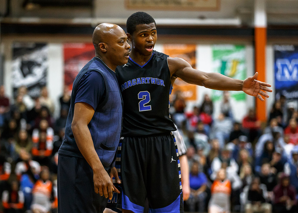 Decatur MacArthur boys basketball head coach Ron Ingram talks with Decatur MacArthur's Armon Brummett (2) during a break in play as the Generals take on Lanphier in the first half at Lober-Nika gymnasium, Saturday, Feb. 10, 2018, in Springfield, Ill. [Justin L. Fowler/The State Journal-Register]
