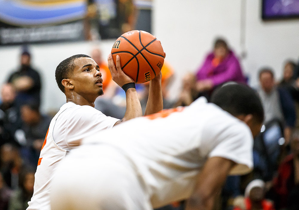 Lanphier's Cardell McGee (12) shoots a set of free throws against Decatur MacArthur in the first half at Lober-Nika gymnasium, Saturday, Feb. 10, 2018, in Springfield, Ill. [Justin L. Fowler/The State Journal-Register]