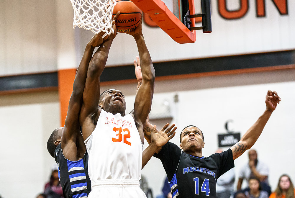 Lanphier's Karl Wright (32) pulls in a rebound against Decatur MacArthur's Majaleus Thomas-Bond (14) in the first half at Lober-Nika gymnasium, Saturday, Feb. 10, 2018, in Springfield, Ill. [Justin L. Fowler/The State Journal-Register]