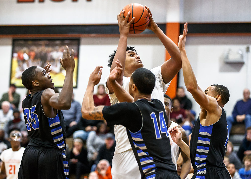 Lanphier's Herb McMath (50) powers up for a shot against a trio of defenders from Decatur MacArthur in the first half at Lober-Nika gymnasium, Saturday, Feb. 10, 2018, in Springfield, Ill. [Justin L. Fowler/The State Journal-Register]