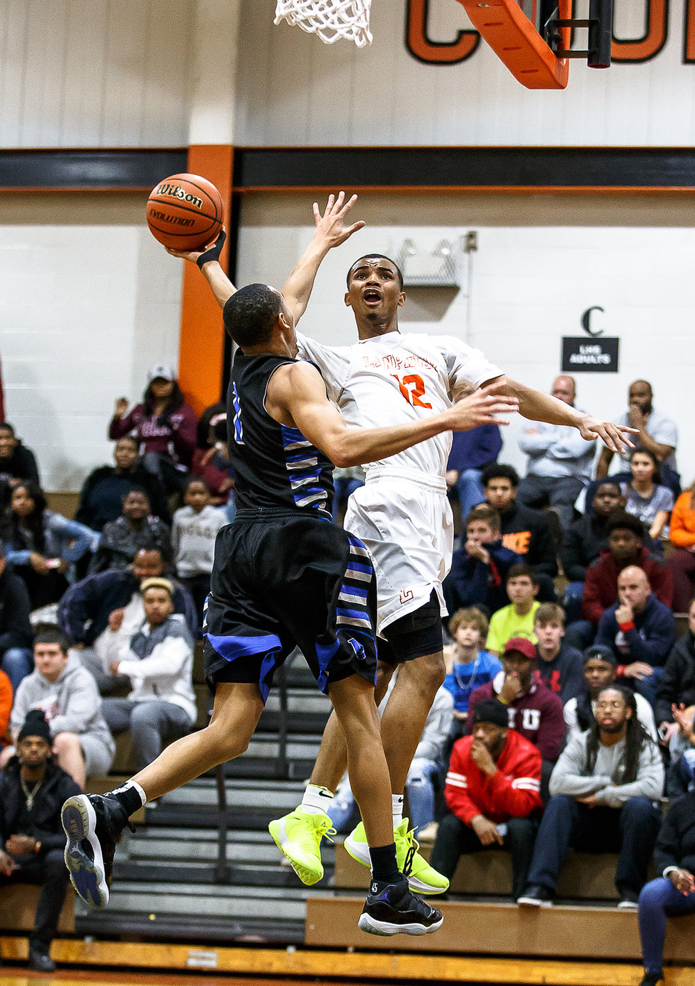 Lanphier's Cardell McGee (12) goes up for a shot against Decatur MacArthur's Zach Briggs (1) in the first half at Lober-Nika gymnasium, Saturday, Feb. 10, 2018, in Springfield, Ill. [Justin L. Fowler/The State Journal-Register]