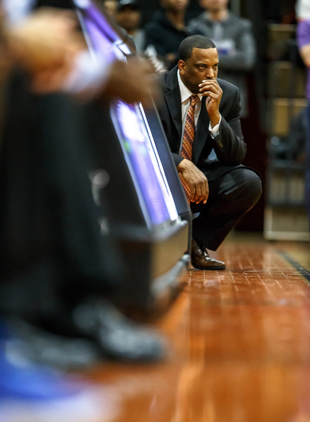 Lanphier boys basketball head coach Blake Turner watches as his team takes on Decatur MacArthur in the first half at Lober-Nika gymnasium, Saturday, Feb. 10, 2018, in Springfield, Ill. [Justin L. Fowler/The State Journal-Register]