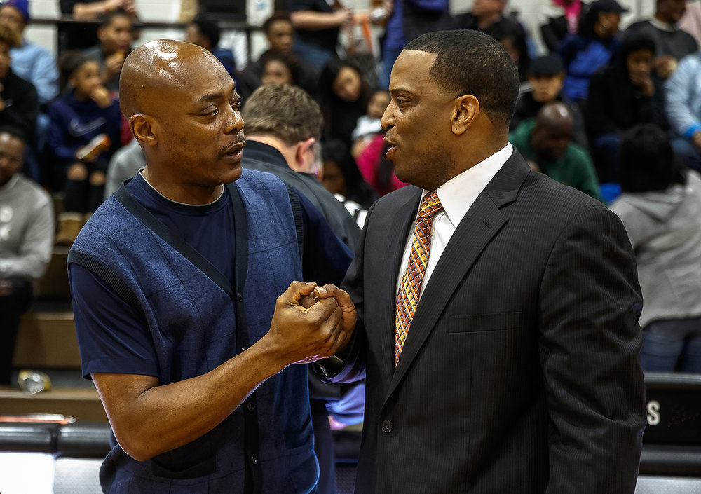 Decatur MacArthur boys basketball head coach Ron Ingram and Lanphier boys basketball head coach Blake Turner talk prior to tip-off at Lober-Nika gymnasium, Saturday, Feb. 10, 2018, in Springfield, Ill. [Justin L. Fowler/The State Journal-Register]
