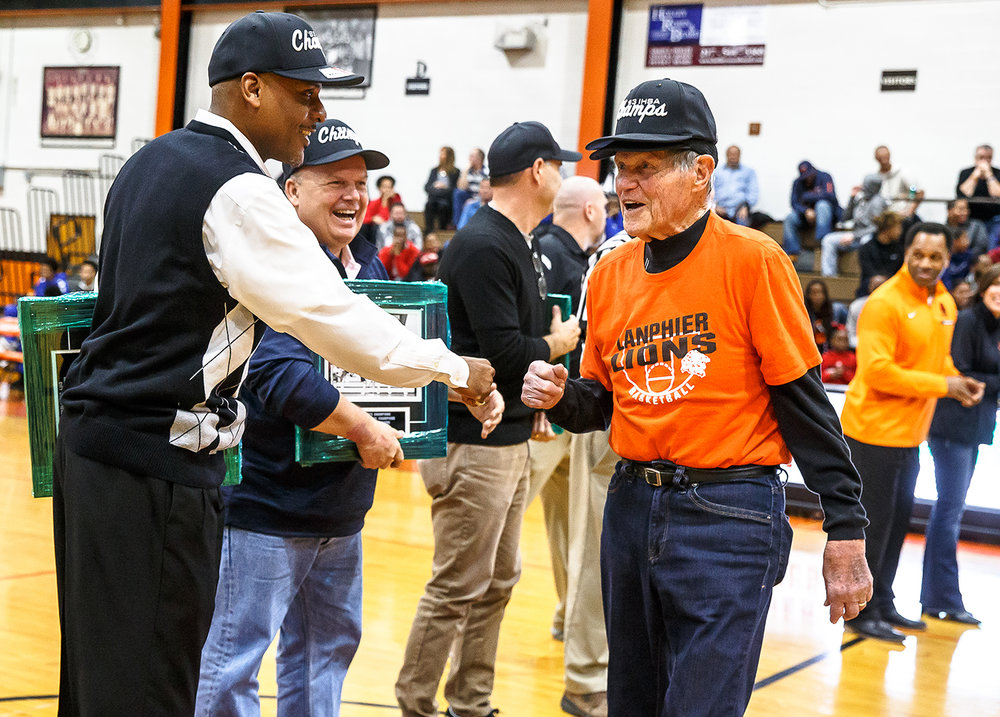 Former Lanphier coach and athletic director Arlyn Lober is honored along with the 1983 State Championship team during halftime as the Lions take on Decatur MacArthur at Lober-Nika gymnasium, Saturday, Feb. 10, 2018, in Springfield, Ill. [Justin L. Fowler/The State Journal-Register]