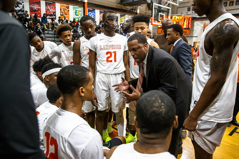 Lanphier boys basketball head coach Blake Turner warns his team to stay out of trouble or they risk forfeiting the game after an altercation broke out against the Lions and Decatur MacArthur in the second half at Lober-Nika gymnasium, Saturday, Feb. 10, 2018, in Springfield, Ill. [Justin L. Fowler/The State Journal-Register]