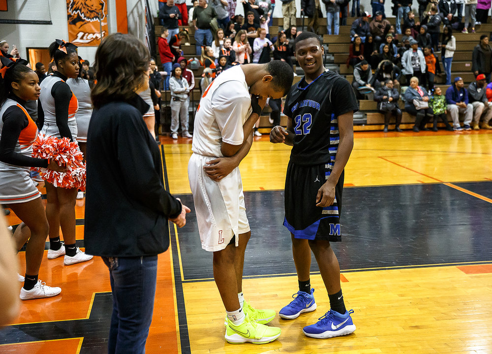 Lanphier's Cardell McGee (12) and Decatur MacArthur's Keenan Ingram (22) share a light moment after a tense game with :00.6 seconds left on the clock with Lanphier up 60-59 in the second half at Lober-Nika gymnasium, Saturday, Feb. 10, 2018, in Springfield, Ill. [Justin L. Fowler/The State Journal-Register]