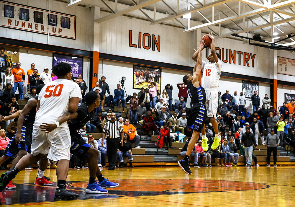 Lanphier's Cardell McGee (12) is fouled by Decatur MacArthur's Zach Briggs (1) as he shoots with the game tied at 59-59 in the second half with :01 seconds left at Lober-Nika gymnasium, Saturday, Feb. 10, 2018, in Springfield, Ill. McGee would miss the shot but hit the game winning free throw to give the go ahead for the Lions' 62-59 victory. [Justin L. Fowler/The State Journal-Register]