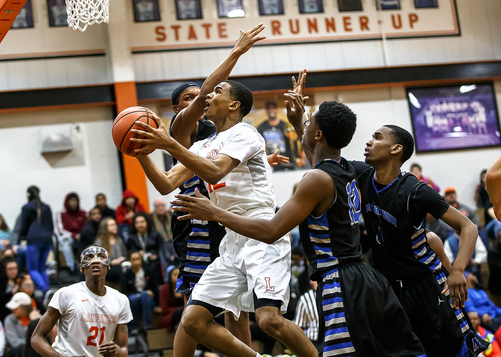 Lanphier's Cardell McGee (12) goes up for a basket against against Decatur MacArthur in the second half at Lober-Nika gymnasium, Saturday, Feb. 10, 2018, in Springfield, Ill. [Justin L. Fowler/The State Journal-Register]