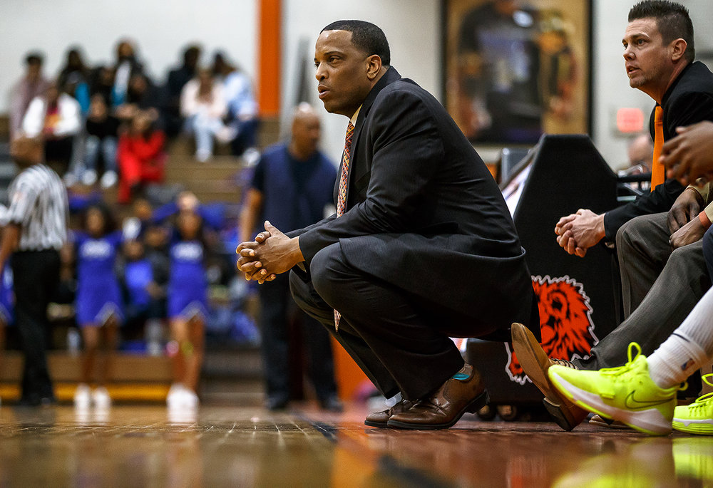 Lanphier boys basketball head coach Blake Turner watches as his team takes on Decatur MacArthur in the second half at Lober-Nika gymnasium, Saturday, Feb. 10, 2018, in Springfield, Ill. [Justin L. Fowler/The State Journal-Register]