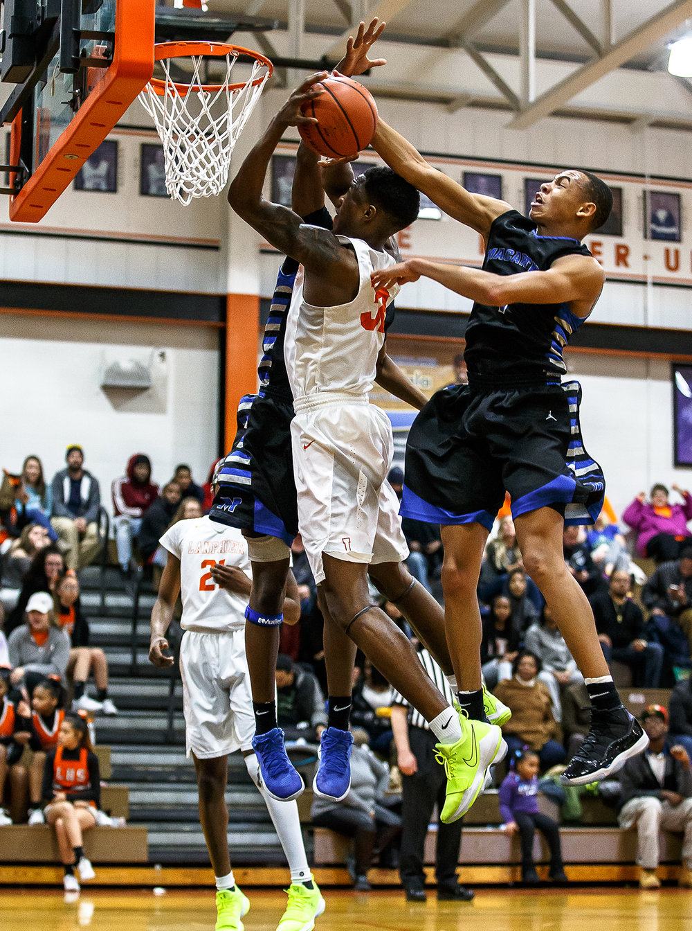 Decatur MacArthur's Zach Briggs (1) fouls Lanphier's Karl Wright (32) as he goes up to the basket in the second half at Lober-Nika gymnasium, Saturday, Feb. 10, 2018, in Springfield, Ill. [Justin L. Fowler/The State Journal-Register]