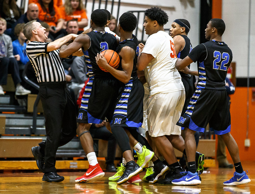 An altercation breaks out between Lanphier and Decatur MacArthur in the second half at Lober-Nika gymnasium, Saturday, Feb. 10, 2018, in Springfield, Ill. [Justin L. Fowler/The State Journal-Register]