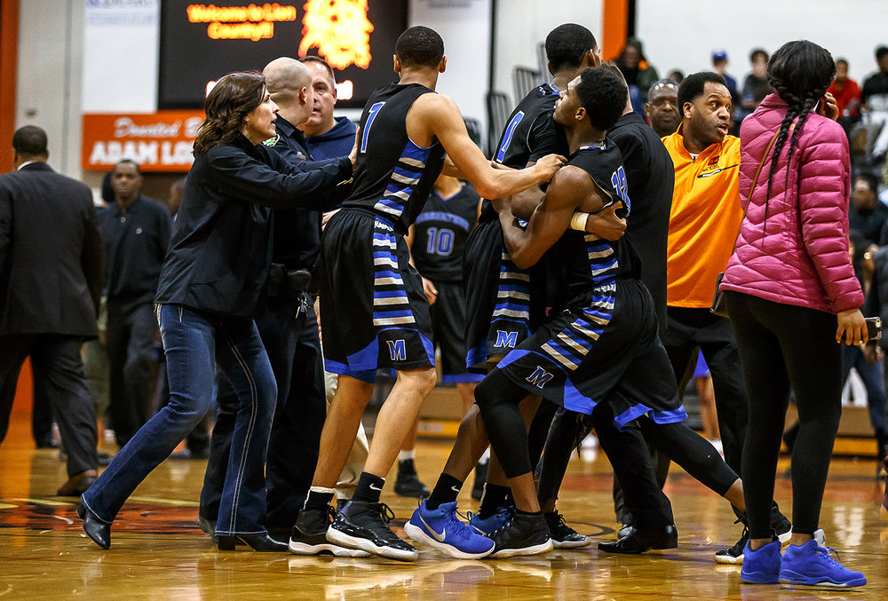 Decatur MacArthur's Amir Brummett (12) is held back by his teammates after an altercation broke out between Lanphier and the Generals in the second half at Lober-Nika gymnasium, Saturday, Feb. 10, 2018, in Springfield, Ill. [Justin L. Fowler/The State Journal-Register]