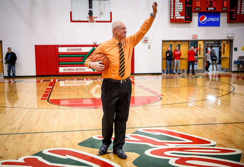 Lincoln boys basketball head coach Neil Alexander waves to the crows after he is recognized with a game ball after getting his 800th win against Effingham after the Railsplitters defeated the Flaming Hearts 45-35 at Effingham High School, Friday, Feb. 9, 2018, in Effingham, Ill. [Justin L. Fowler/The State Journal-Register]