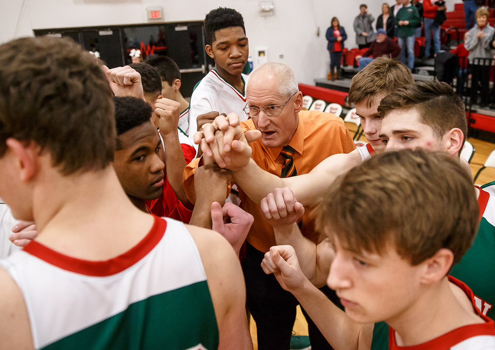 Lincoln boys basketball head coach Neil Alexander huddles with his team as they prepare to take on Effingham at Effingham High School, Friday, Feb. 9, 2018, in Effingham, Ill. [Justin L. Fowler/The State Journal-Register]