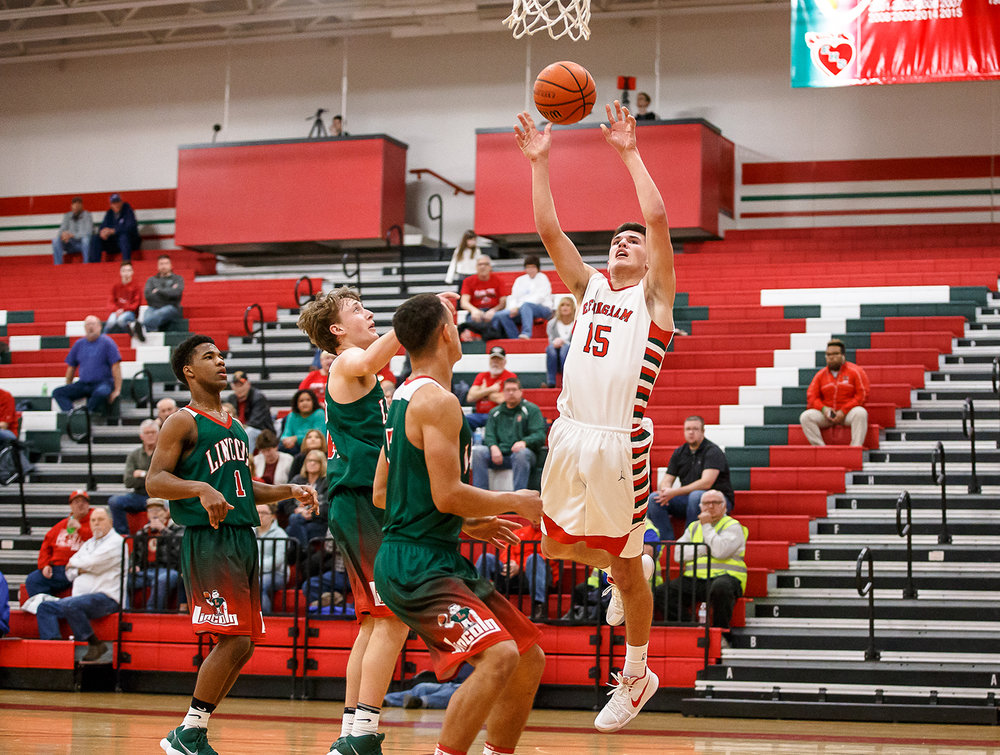 Effingham's Landon Wolfe (15) goes up for a shot against Lincoln in the first half at Effingham High School, Friday, Feb. 9, 2018, in Effingham, Ill. [Justin L. Fowler/The State Journal-Register]