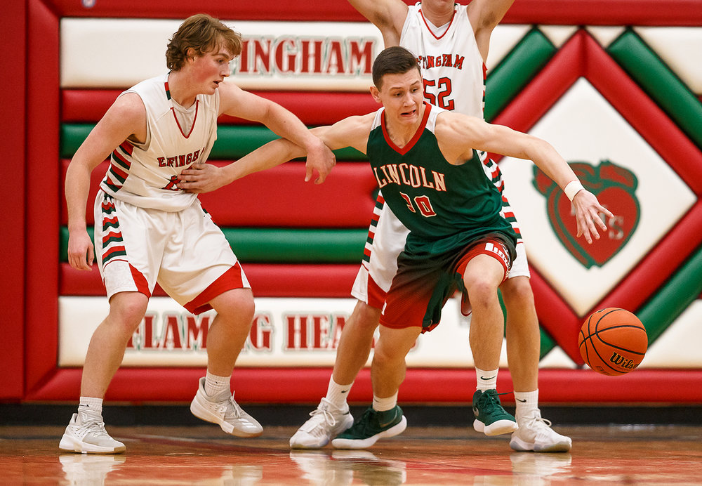 Lincoln's Colton Holliday (30) goes after possession of the ball against Effingham's Mason Hull (21) in the first half at Effingham High School, Friday, Feb. 9, 2018, in Effingham, Ill. [Justin L. Fowler/The State Journal-Register]