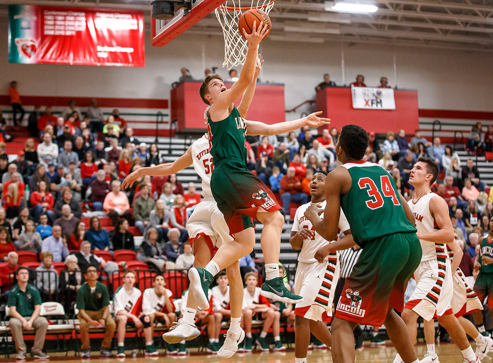 Lincoln's Ben Grunder (24) goes up underneath the basket for a shot against Effingham's Cole Marxman (52) in the second half at Effingham High School, Friday, Feb. 9, 2018, in Effingham, Ill. [Justin L. Fowler/The State Journal-Register]