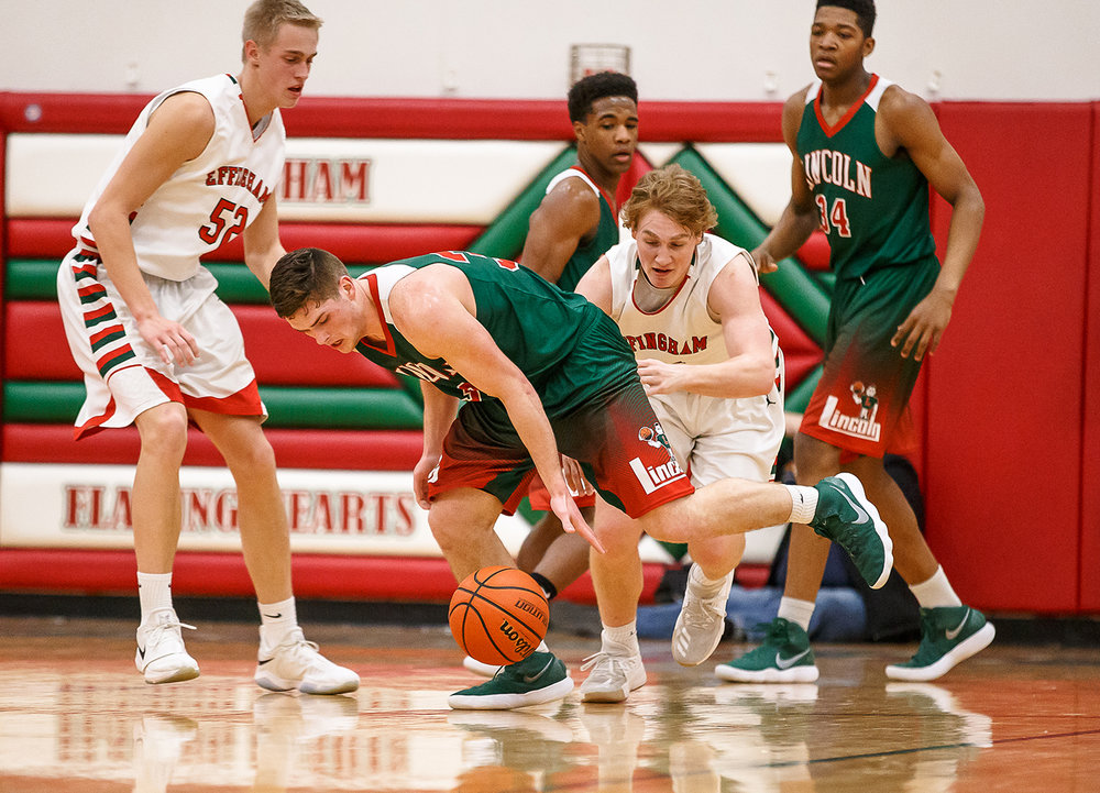 Lincoln's Isaiah Bowers (33) steals the ball away from Effingham's Mason Hull (21) in the second half at Effingham High School, Friday, Feb. 9, 2018, in Effingham, Ill. [Justin L. Fowler/The State Journal-Register]