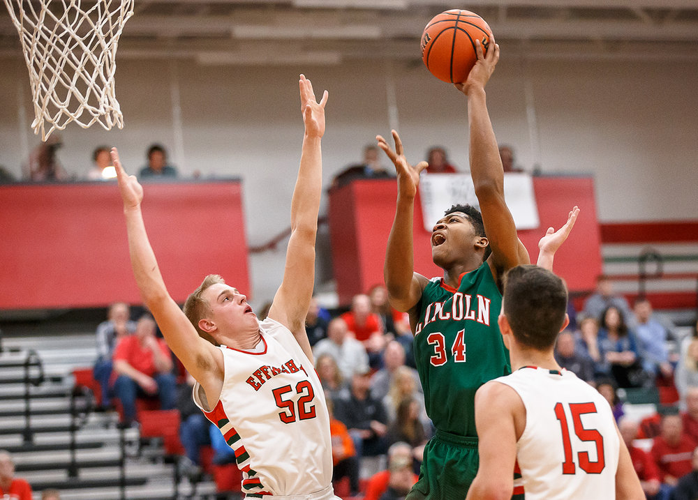 Lincoln's Jermaine Hamlin (34) goes up for a shot against Effingham's Cole Marxman (52) in the second half at Effingham High School, Friday, Feb. 9, 2018, in Effingham, Ill. [Justin L. Fowler/The State Journal-Register]