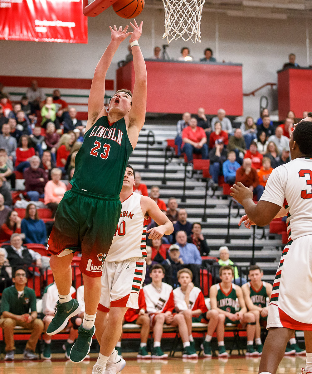 Lincoln's Drew Bacon (23) goes up for a basket against Effingham's Logan Smith (40) in the second half at Effingham High School, Friday, Feb. 9, 2018, in Effingham, Ill. [Justin L. Fowler/The State Journal-Register]