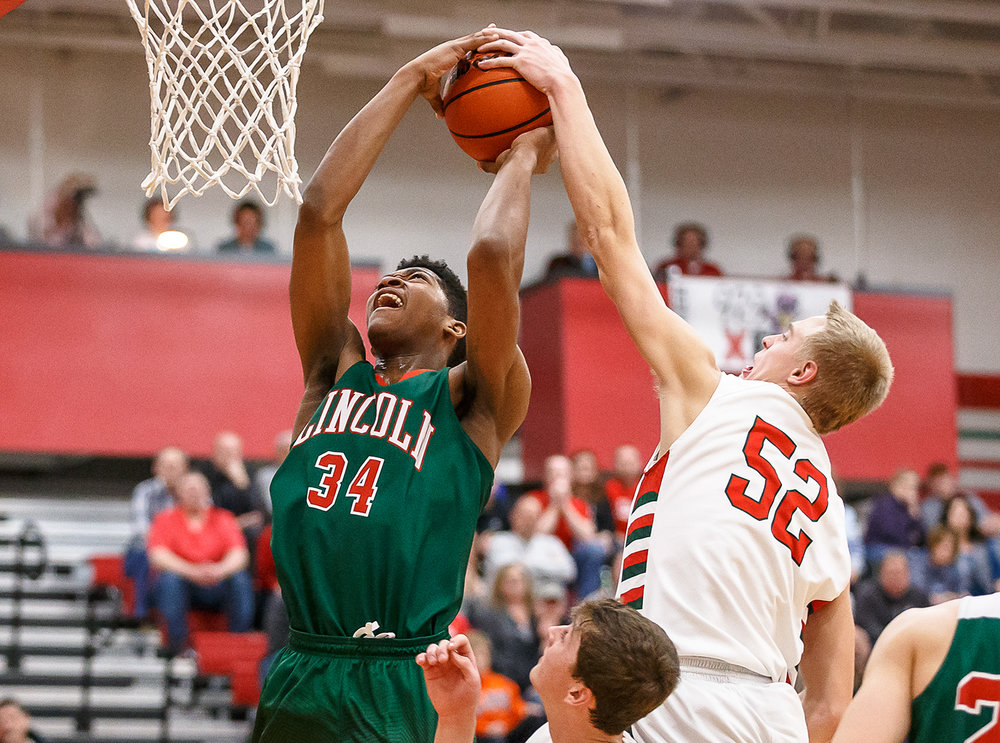 Lincoln's Jermaine Hamlin (34) draws the foul as he goes up to the basket against Effingham's Cole Marxman (52) in the second half at Effingham High School, Friday, Feb. 9, 2018, in Effingham, Ill. [Justin L. Fowler/The State Journal-Register]