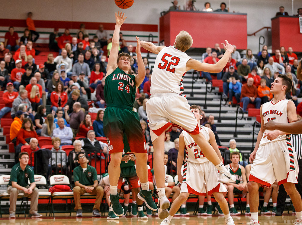 Lincoln's Ben Grunder (24) tries to get a shot off in front of Effingham's Cole Marxman (52) in the second half at Effingham High School, Friday, Feb. 9, 2018, in Effingham, Ill. [Justin L. Fowler/The State Journal-Register]