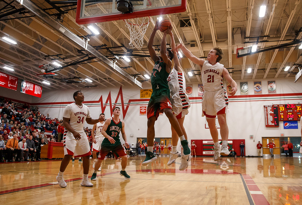 Lincoln's Jermaine Hamlin (34) goes up to the basket against Effingham's Mason Hull (21) and Effingham's Cole Marxman (52) in the second half at Effingham High School, Friday, Feb. 9, 2018, in Effingham, Ill. [Justin L. Fowler/The State Journal-Register]