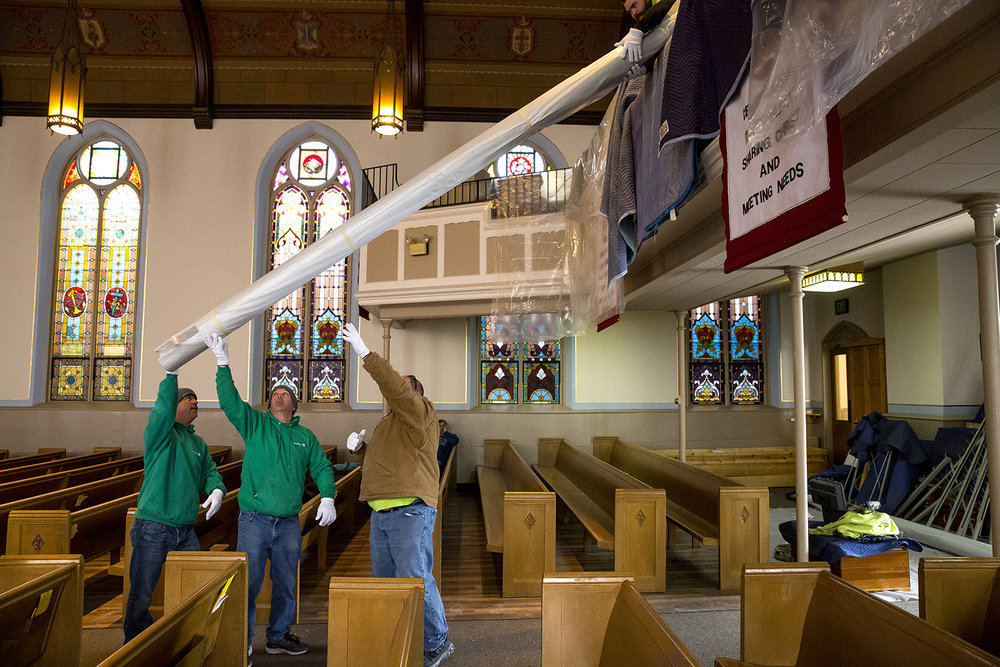 Employees of Underfanger Moving and Storage lift one of the 16 pedal pipes, the largest and heaviest in a pipe organ, up to the choir loft of Trinity Lutheran Church at Second and Monroe streets Tuesday, Feb. 6, 2018. As part of the church's $1.5 million renovation and expansion, parts of the organ were packed up in August and sent to JL Weiler, Inc., an organ conservator in Chicago, and to the builder, Cassavant Frres of Canada, for restoration and cleaning. The pieces returned to the church and will be reassembled and tuned during the next month. The church renovation is expected to be complete in April. [Rich Saal/The State Journal-Register]