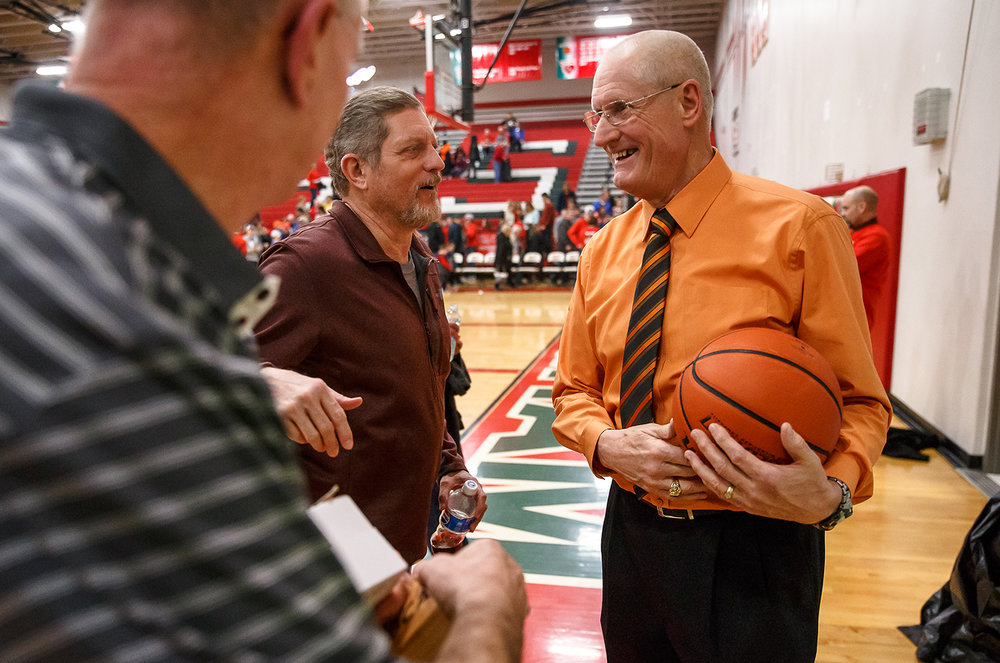 Lincoln boys basketball head coach Neil Alexander is congratulated by fans after getting his 800th win against Effingham after the Railsplitters defeated the Flaming Hearts 45-35 at Effingham High School, Friday, Feb. 9, 2018, in Effingham, Ill. [Justin L. Fowler/The State Journal-Register]