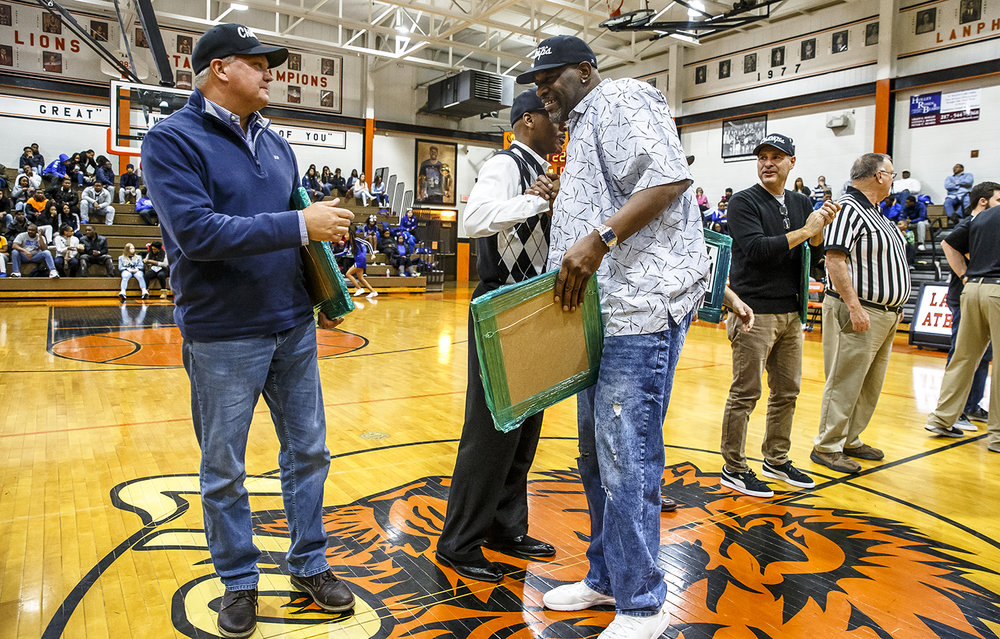 Lanphier's Ed Horton, Mr. Basketball of Illinois 1985, joins his teammates of the State Championship team from 1983 as they are honored during halftime as the Lions take on Decatur MacArthur at Lober-Nika gymnasium, Saturday, Feb. 10, 2018, in Springfield, Ill. [Justin L. Fowler/The State Journal-Register]